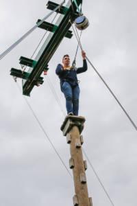 Sam Sefton, senior analyst, scaling the climbing pole.